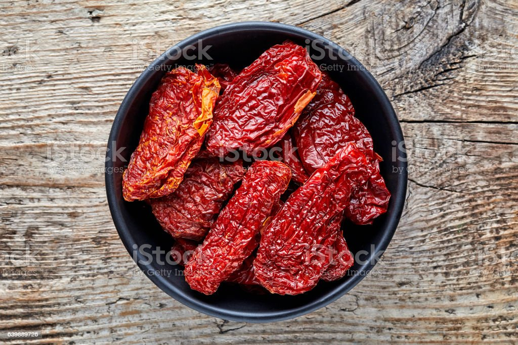 Bowl of sun dried tomatoes from above stock photo