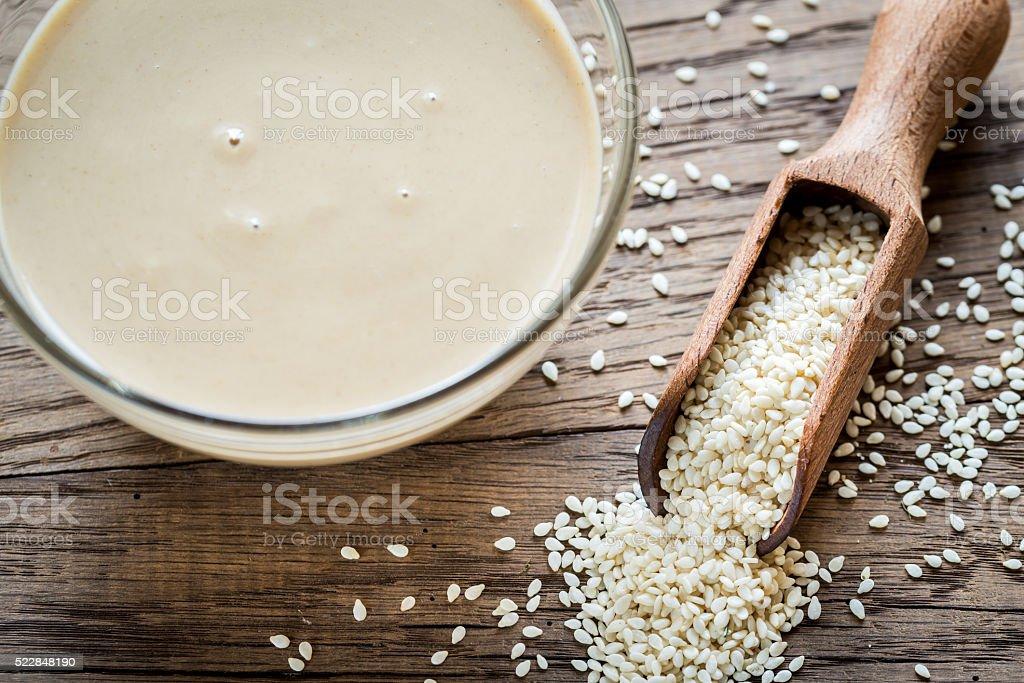 Bowl of tahini with sesame seeds stock photo