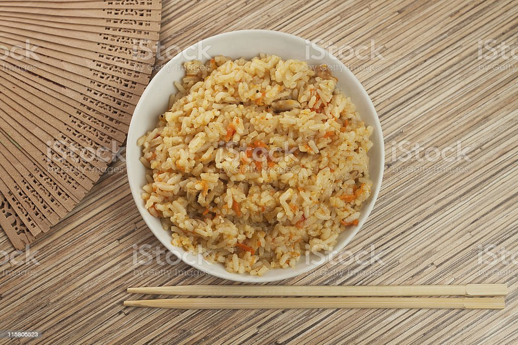 bowl of tasty cooked rice with chopsticks royalty-free stock photo