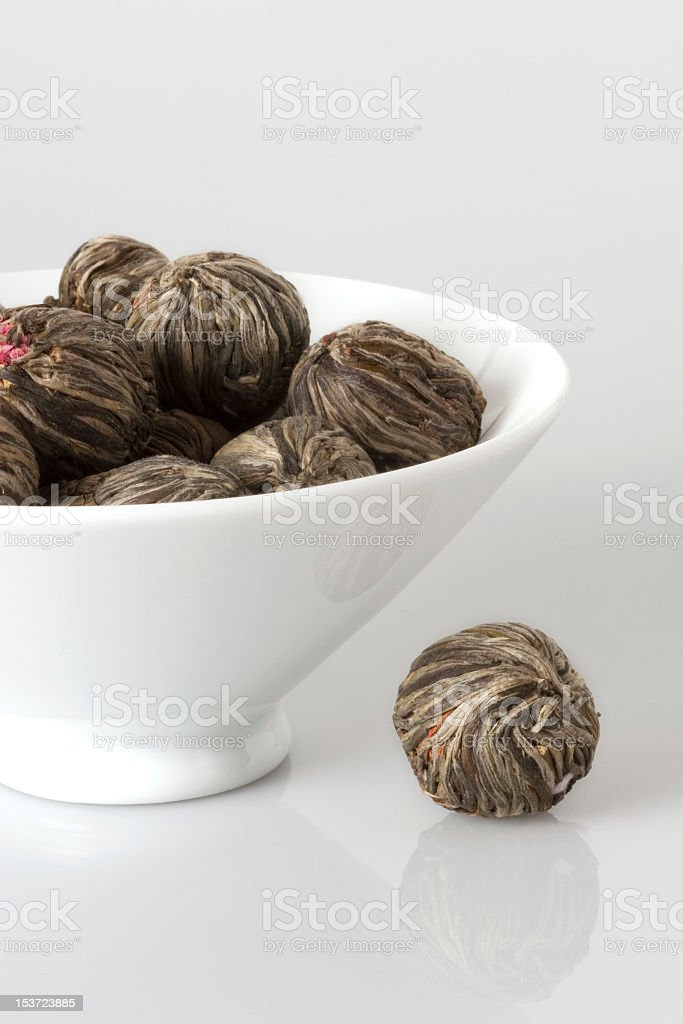 Bowl of tea bud on white background stock photo