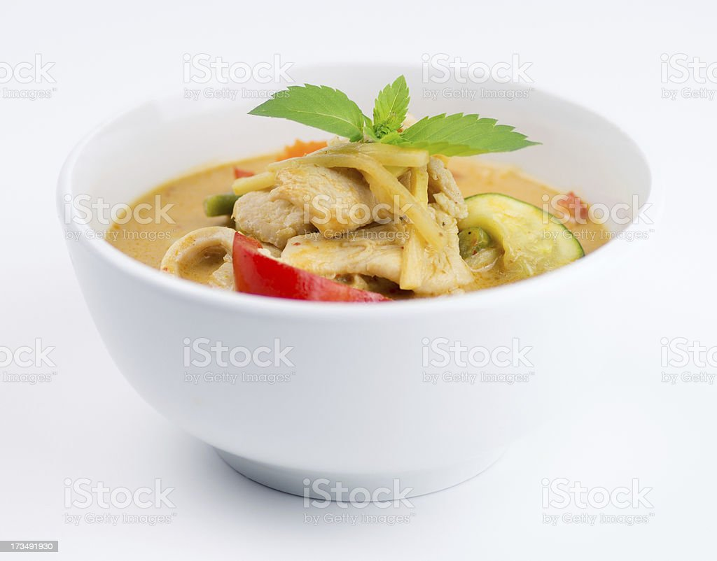 Bowl of Thai chicken red curry isolated on white background stock photo