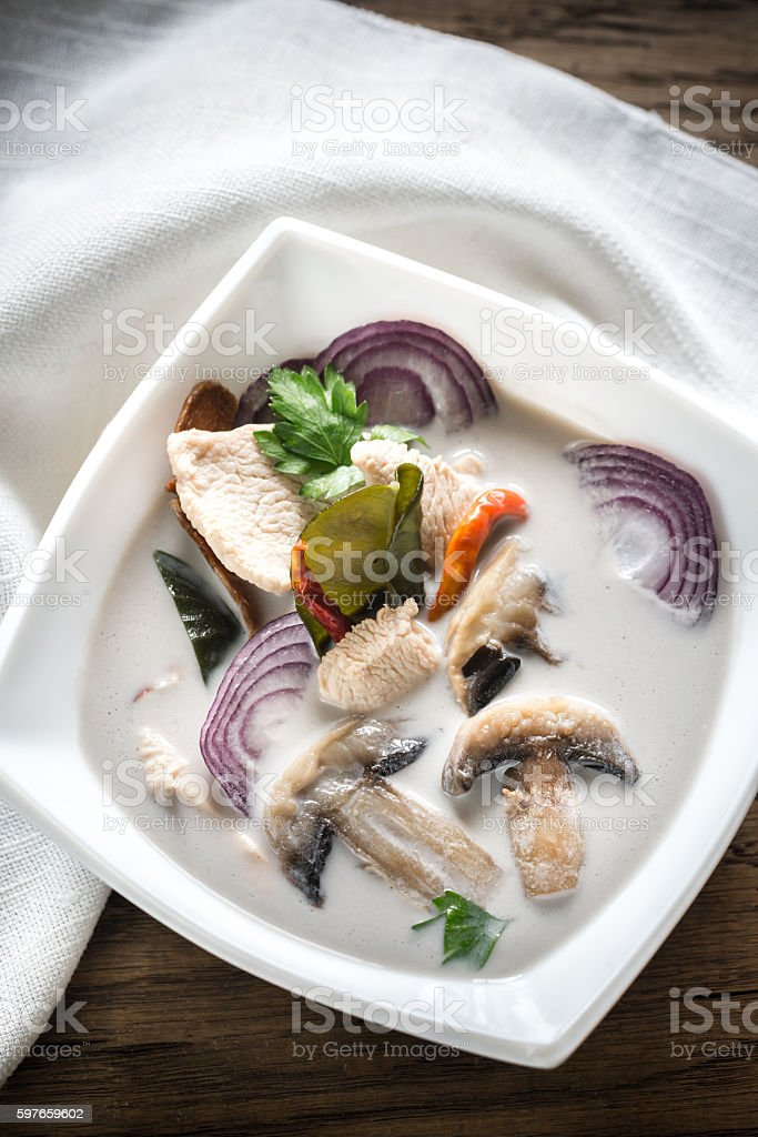 Bowl of thai tom kha kai soup stock photo