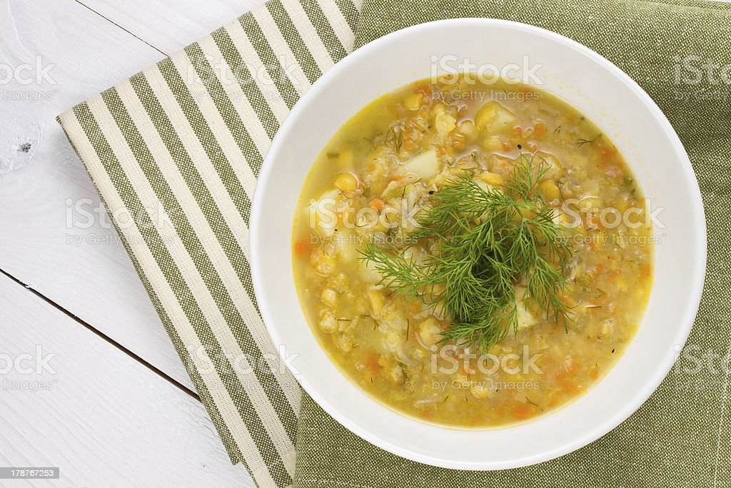 bowl of thick, fresh, pea soup with herbs stock photo