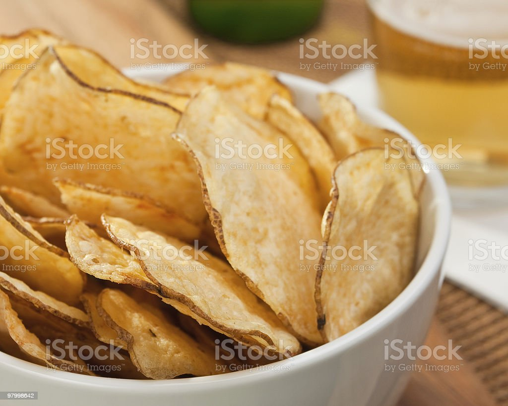 Bowl of thinly cut potato chips stock photo