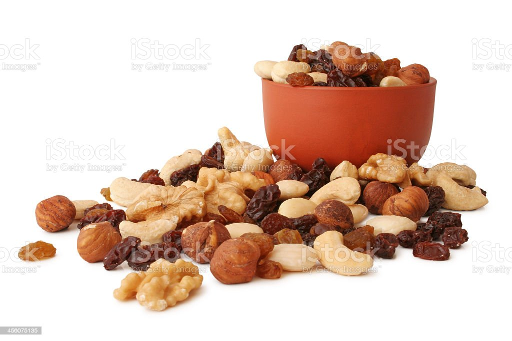 Bowl of trail mix with more trail mix in front  stock photo