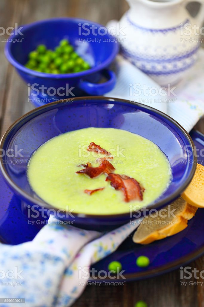 Bowl of vegetable soup with ham stock photo