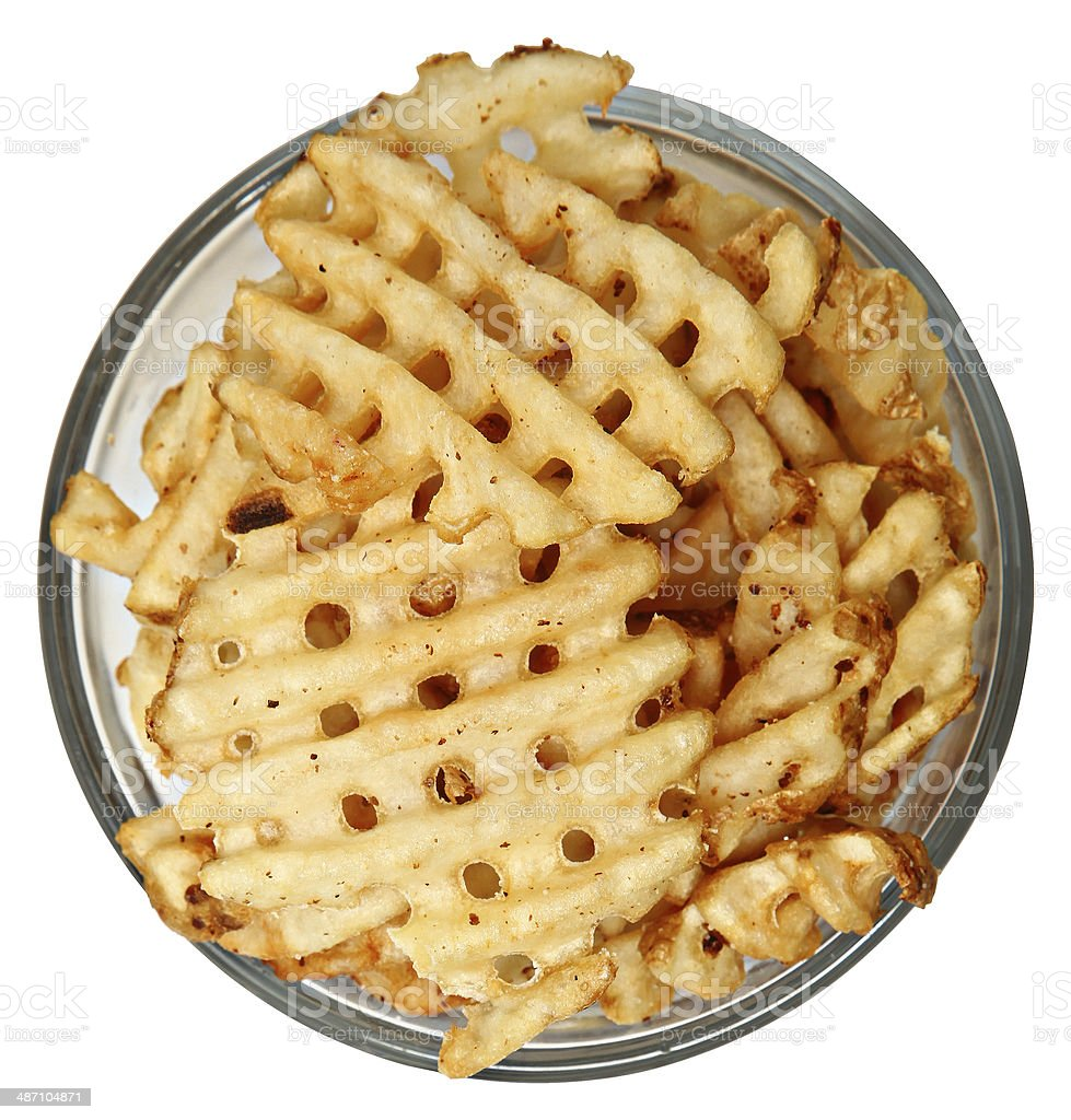 Bowl of Waffle Fries Over White stock photo