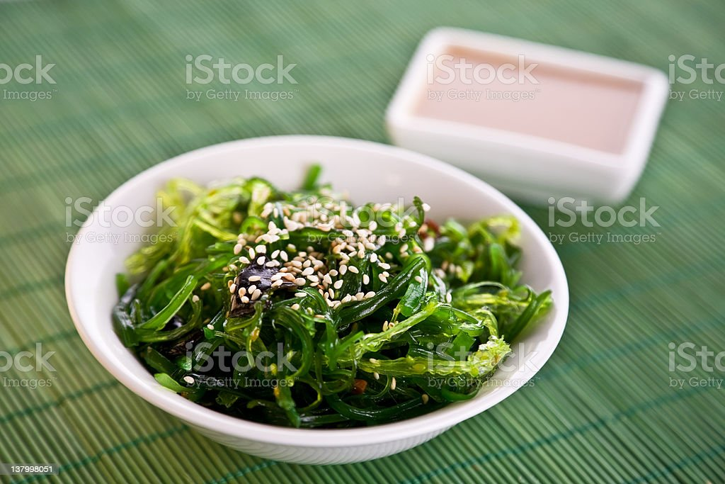 A bowl of Wakame seaweed salad stock photo
