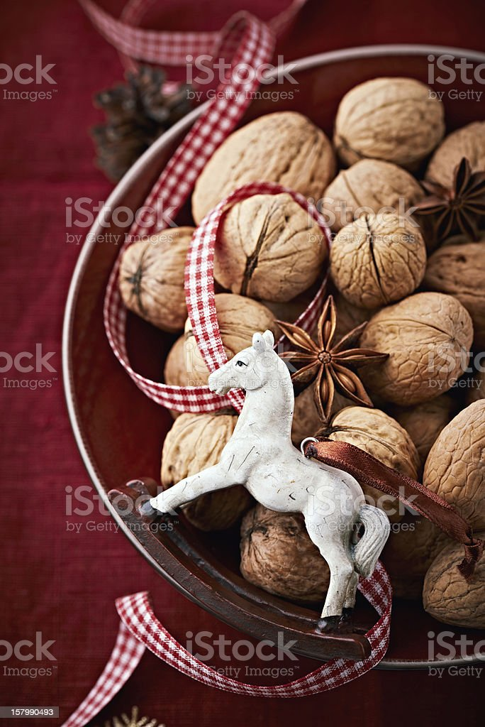 Bowl of walnuts and star anise for christmas stock photo