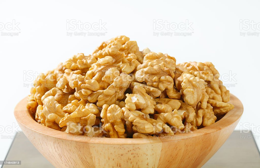 bowl of walnuts on a digital scale royalty-free stock photo