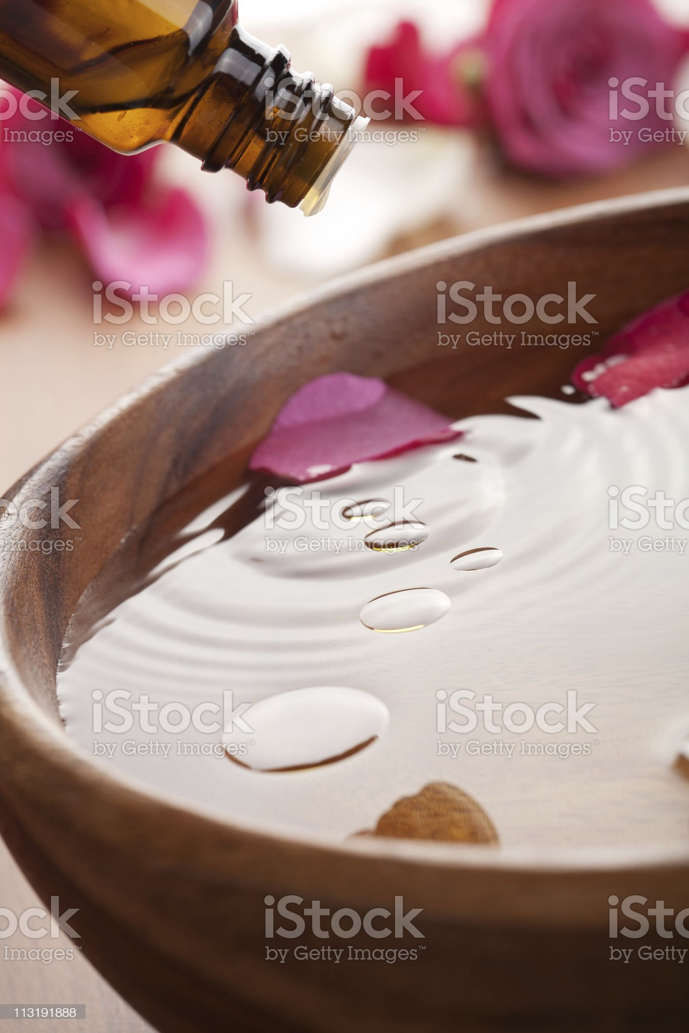 Bowl of water pouring oil for aromatherapy royalty-free stock photo