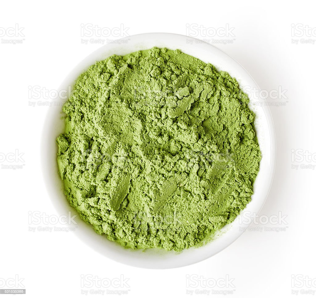 Bowl of wheat grass isolated on white, from above stock photo
