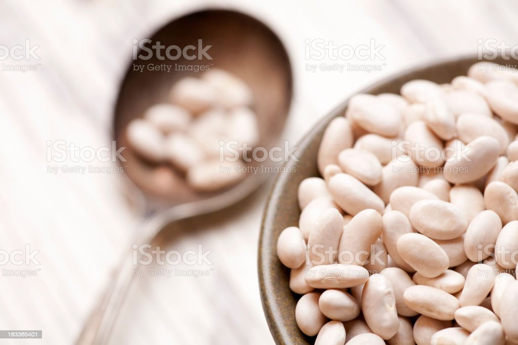 bowl of white beans stock photo