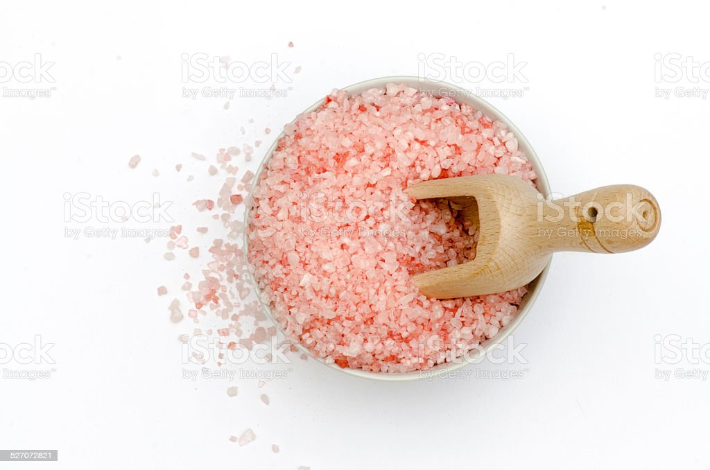 bowl, rose bath salts, spoon, white background, top view stock photo