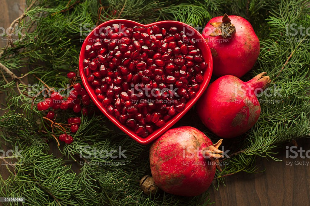Bowl with cleaned pomegranate. stock photo