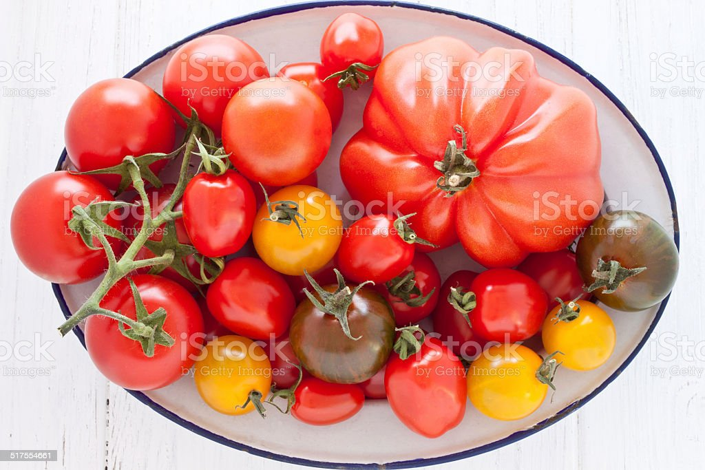 Bowl with colorful tomatoes stock photo