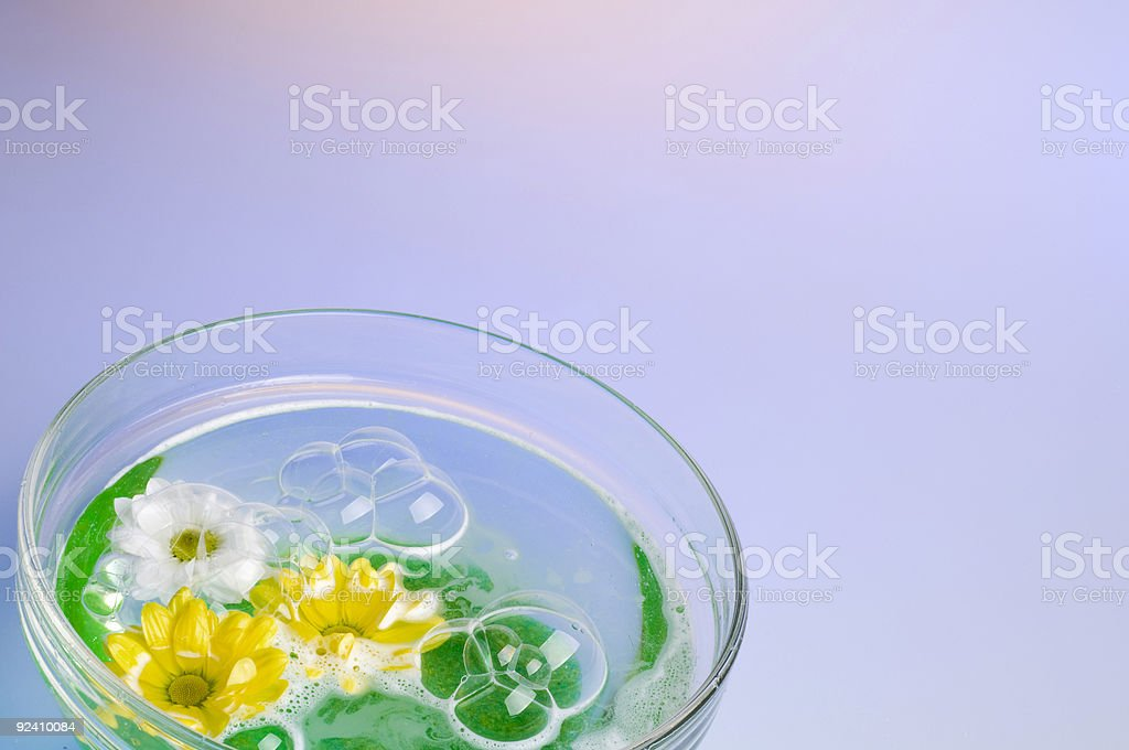 Bowl with dissolved sea salt and flowers. royalty-free stock photo