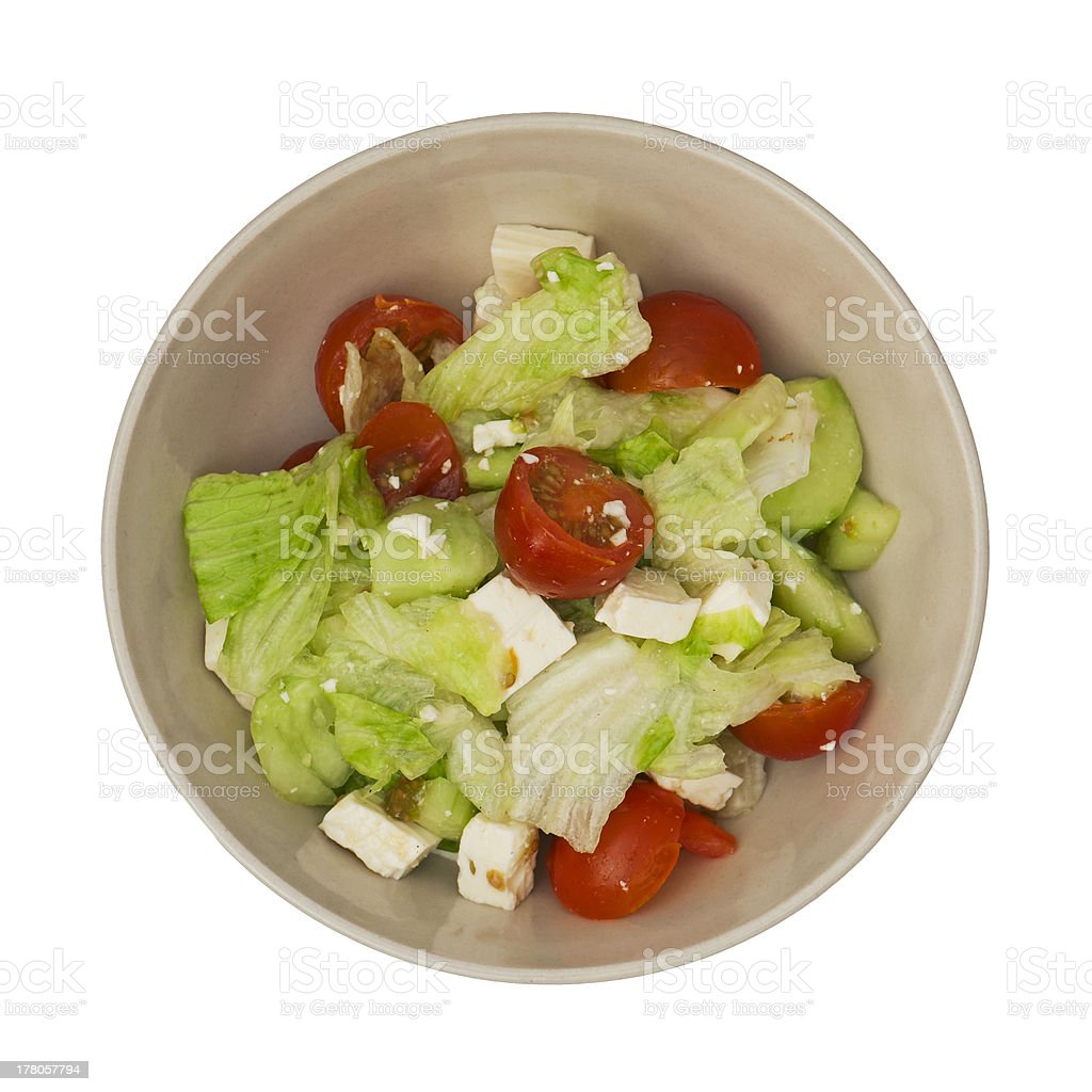 Bowl with fetta salad on a white background stock photo