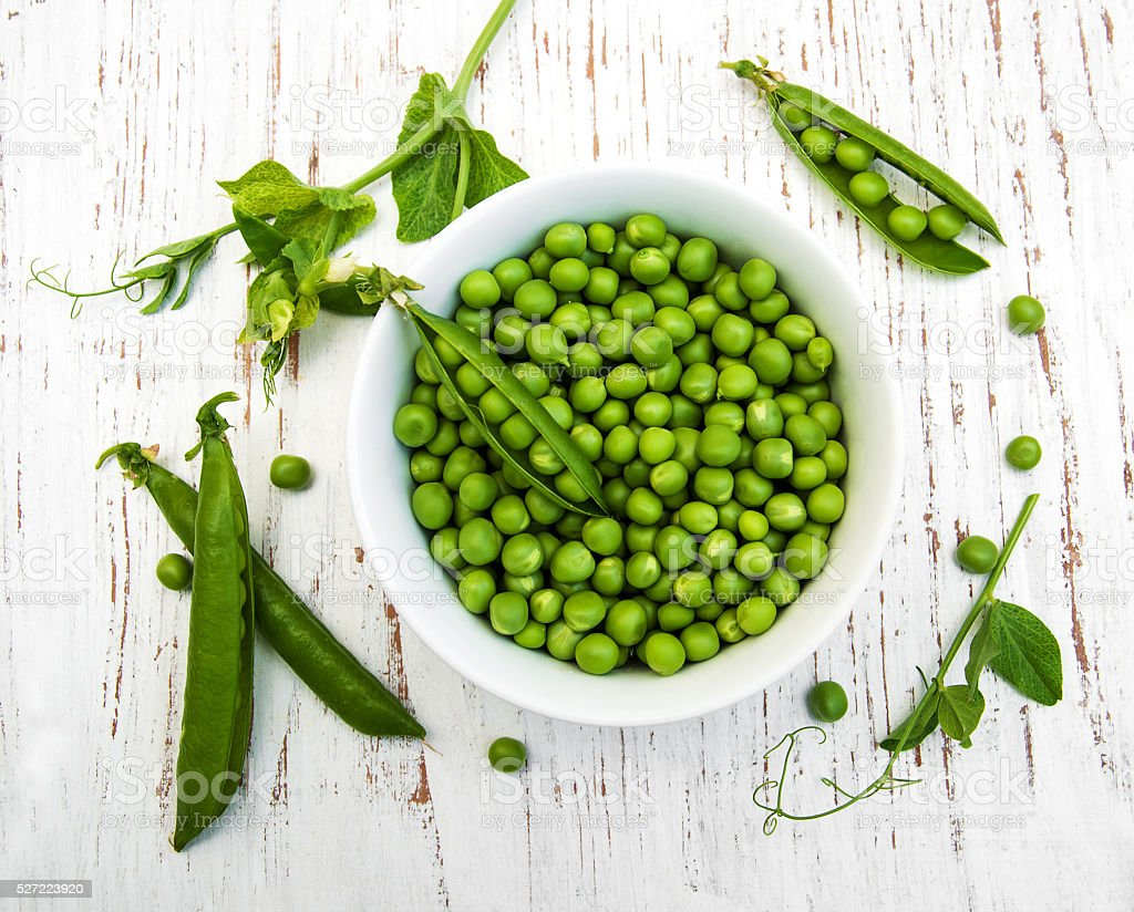 Bowl with fresh peas stock photo