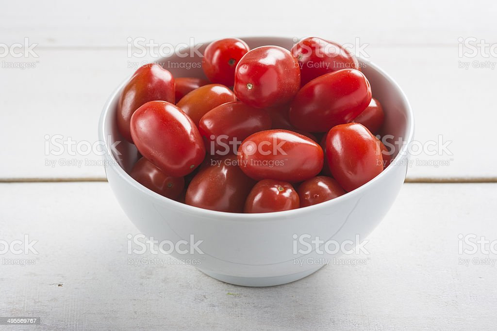 Bowl with grape tomatoes stock photo