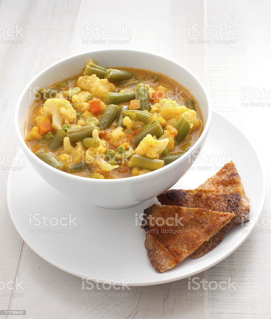 Bowl with hearty vegetable curry thai soup stock photo