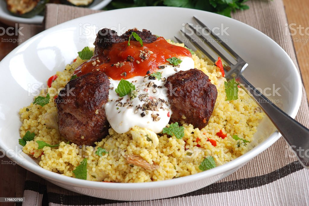 A bowl with meatballs and couscous royalty-free stock photo