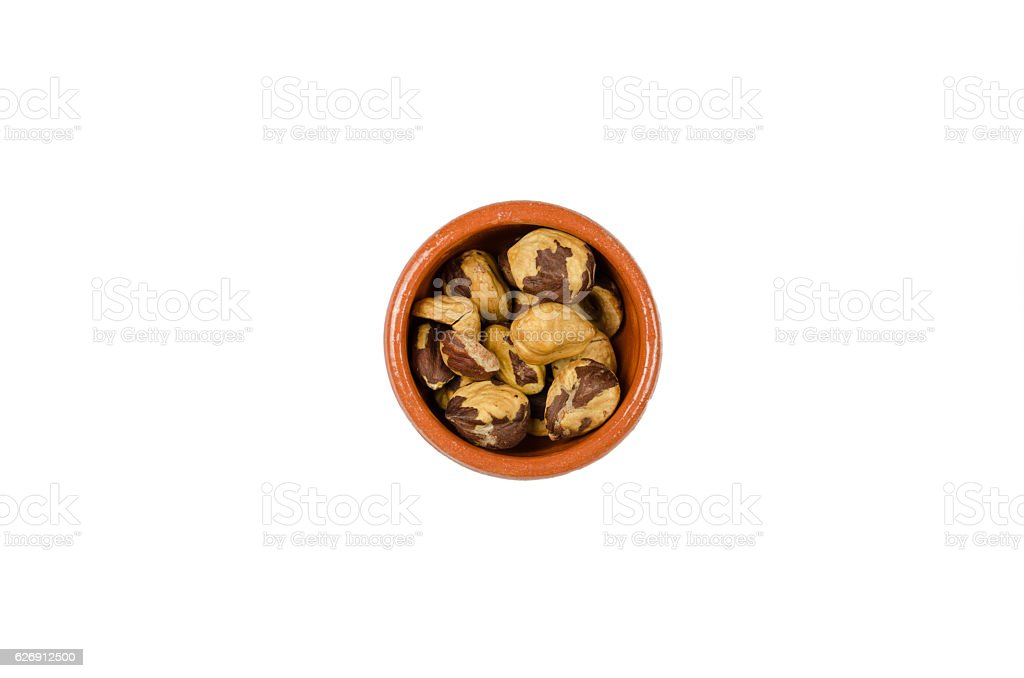 bowl with nuts on the white background stock photo