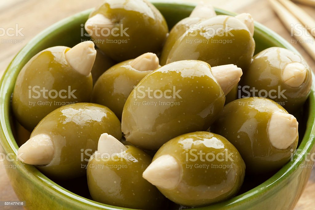 Bowl with olives stuffed with an almond stock photo