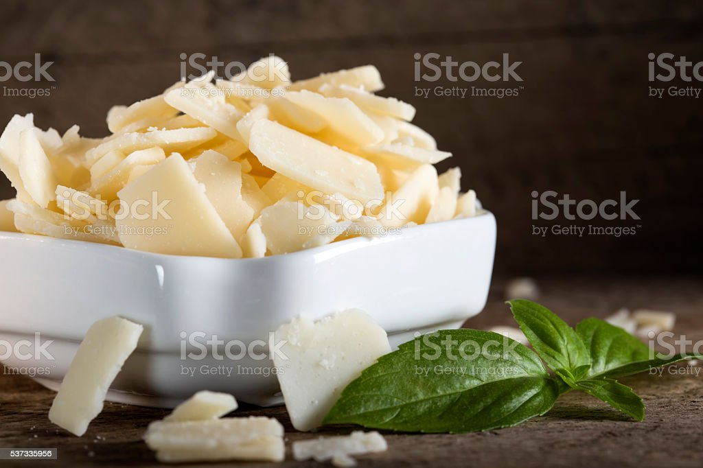 Bowl with parmesan cheese flakes stock photo