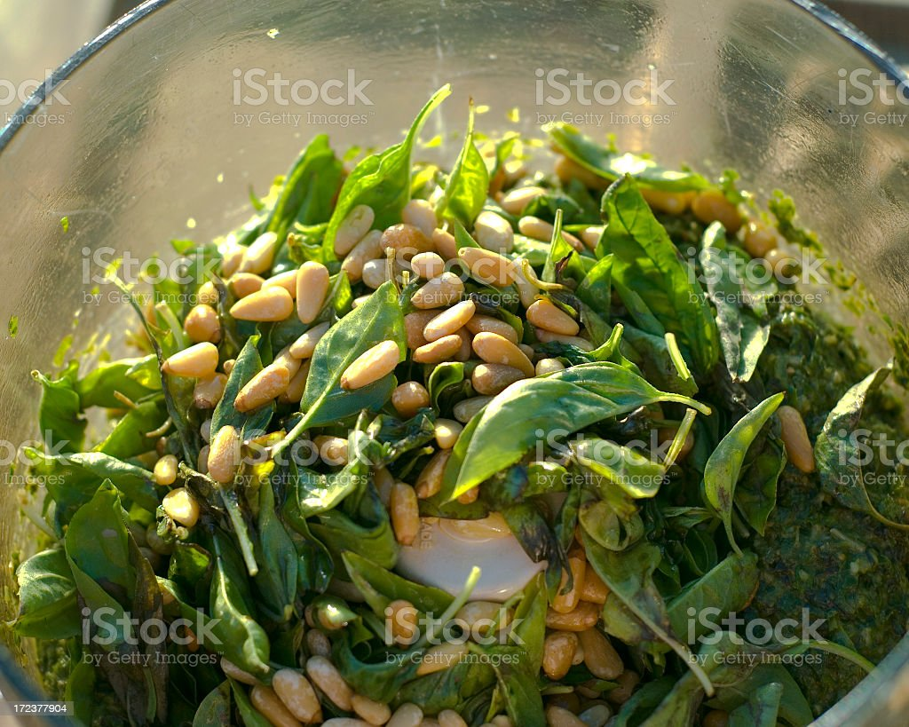 A bowl with pesto sauce and some Italian food stock photo