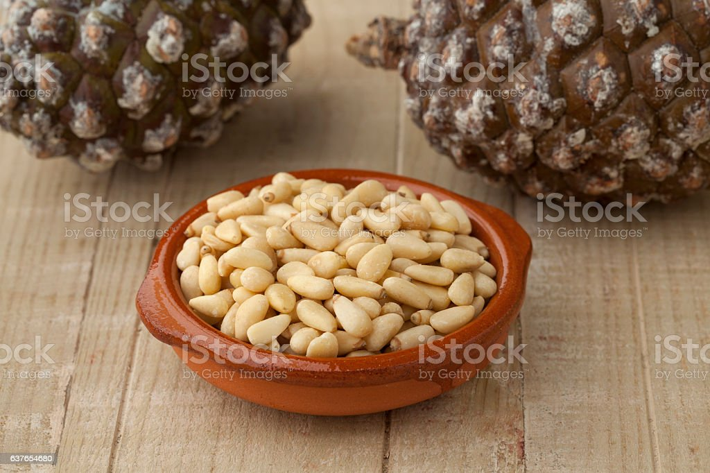 Bowl with pine nuts stock photo