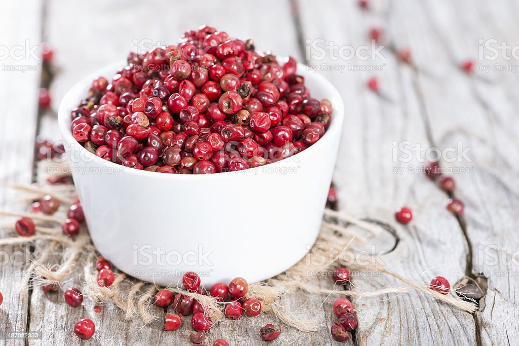 Bowl with Pink Peppercorns stock photo