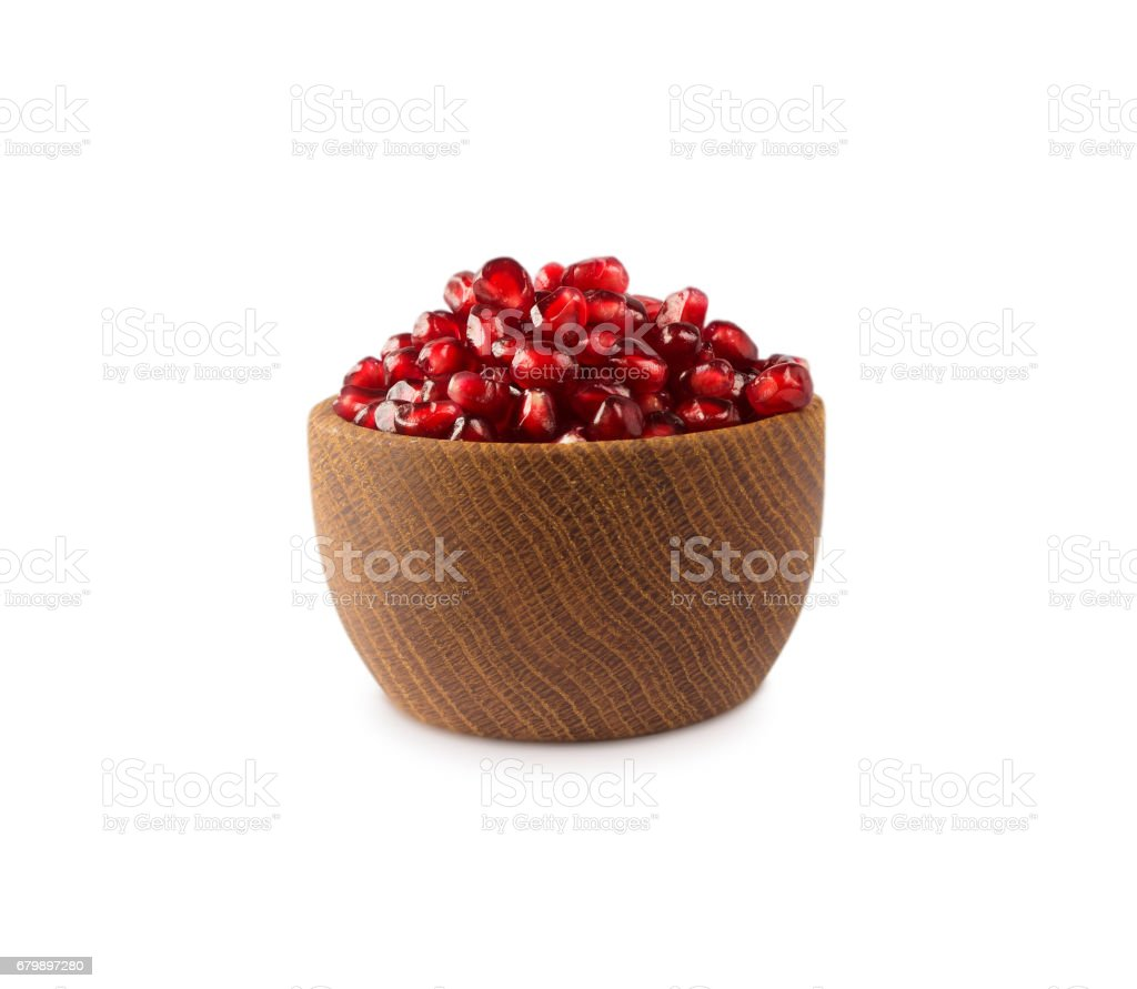 bowl with pomegranate seeds isolated on white background. stock photo