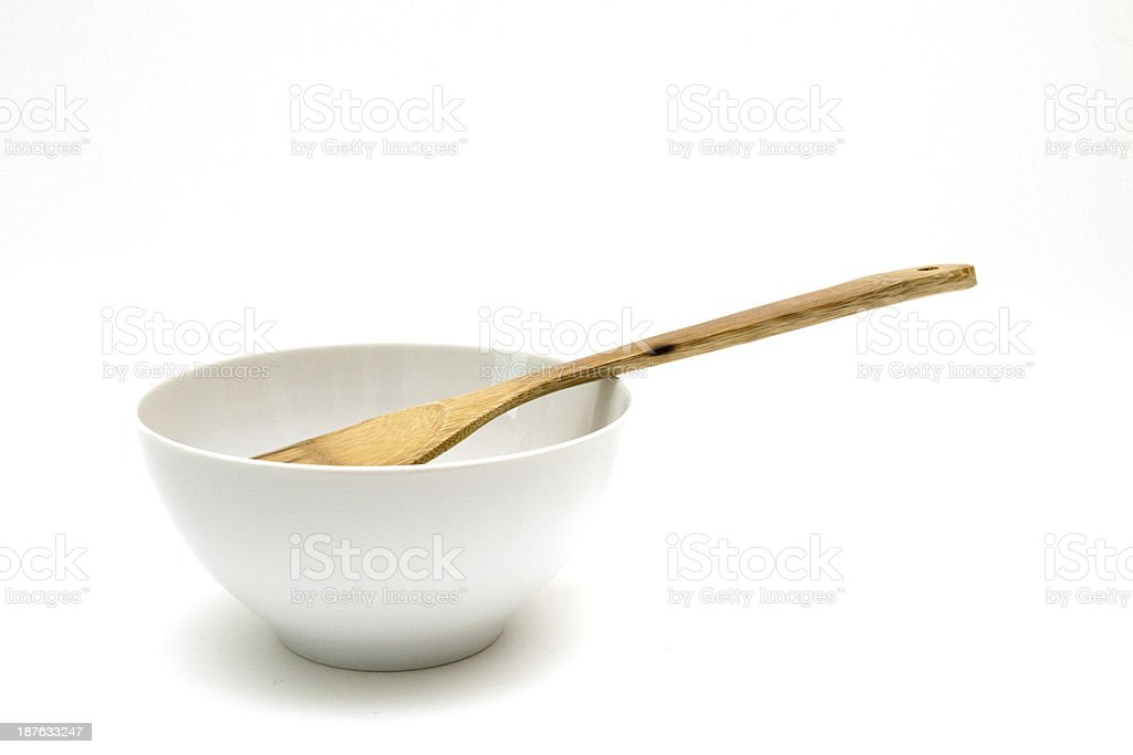 Bowl with wooden spoon stock photo