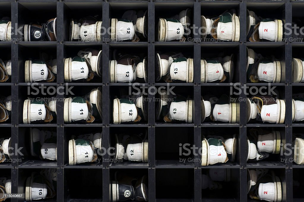 Bowling Alley Rental Shoes in a Shoe Storage Rack stock photo