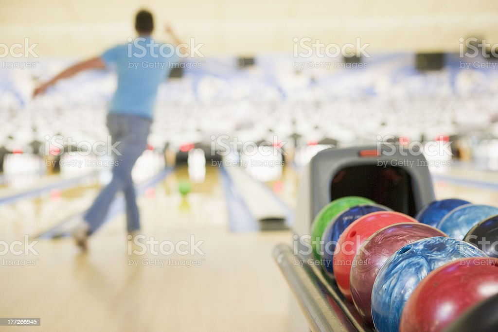 Bowling alley with man in background stock photo