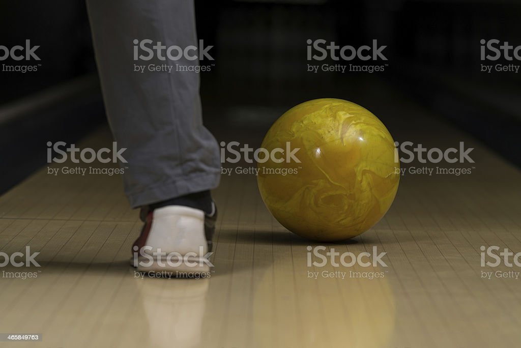 Bowling Ball Next To The Foot stock photo