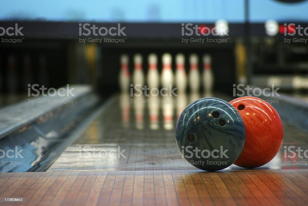 \'two bowling balls focused and at the end, the pins waiting for the...