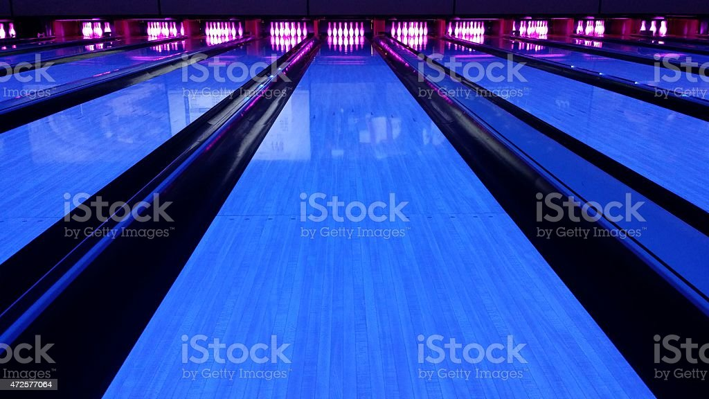 bowling lane black light stock photo