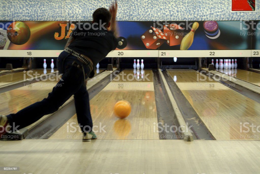 bowling with orange ball stock photo