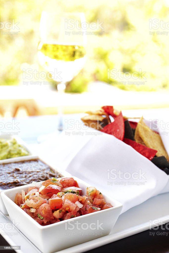 Bowls containing Nachos guacamole and tomato dip royalty-free stock photo