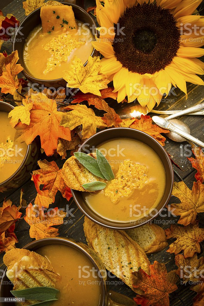 Bowls Of Butternut Squash Soup In A Table stock photo