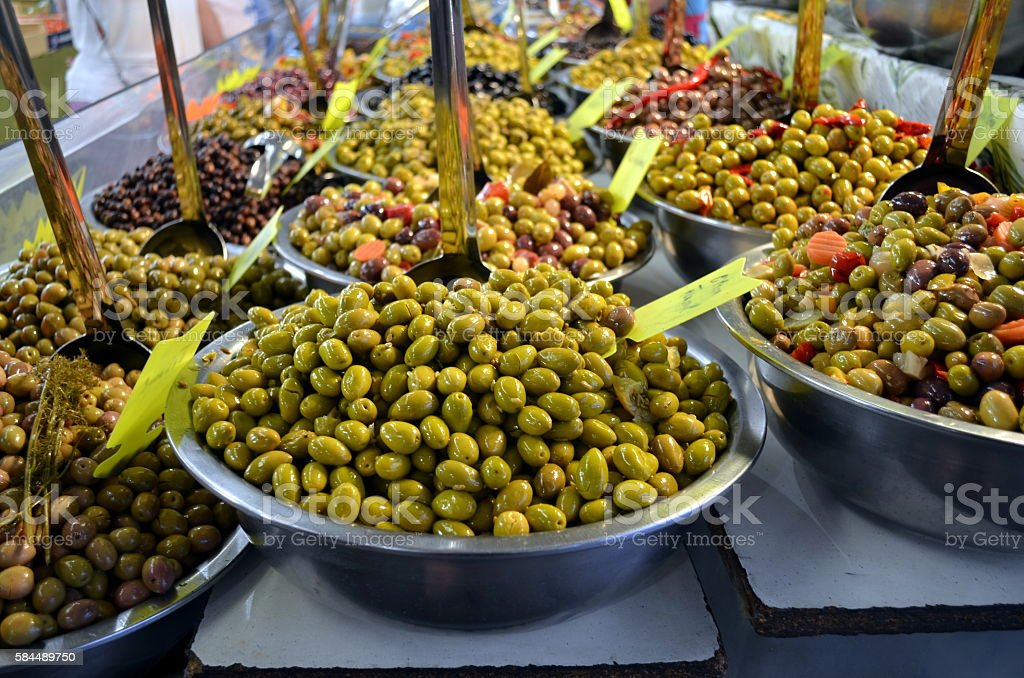 Bowls of olives for sale at a market in france stock photo