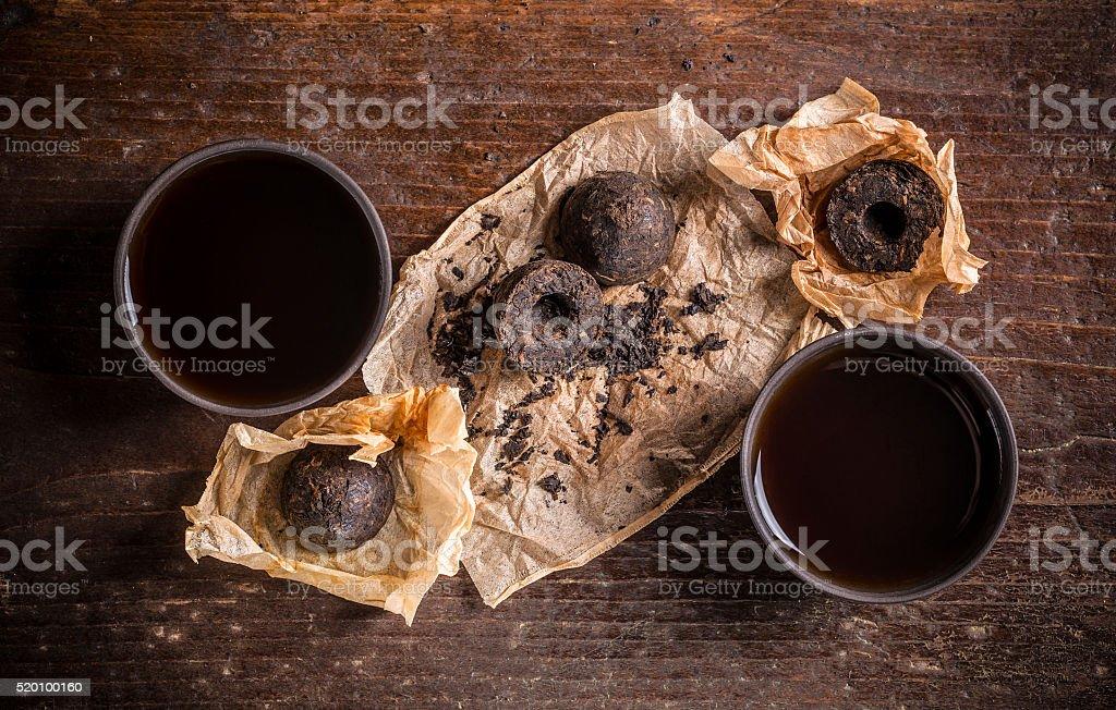 Bowls of pu erh tea stock photo
