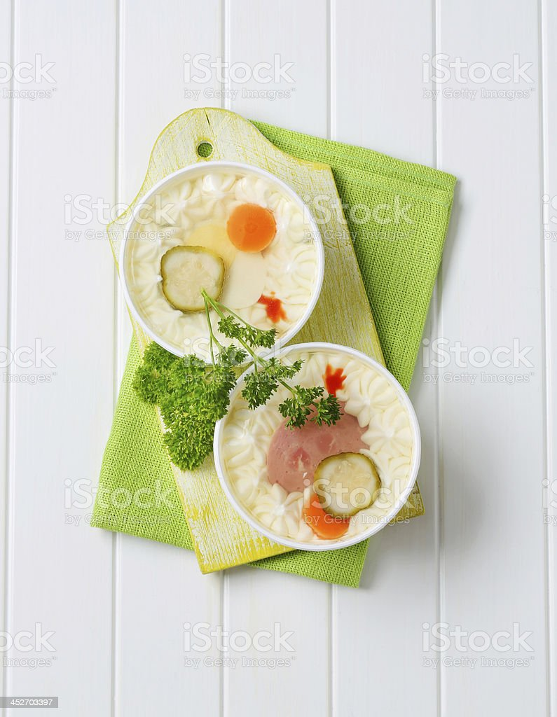 Bowls of salami and egg in aspic stock photo