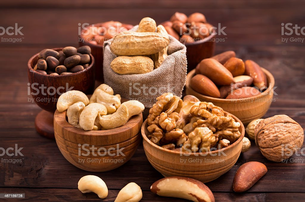 Bowls of various nuts stock photo