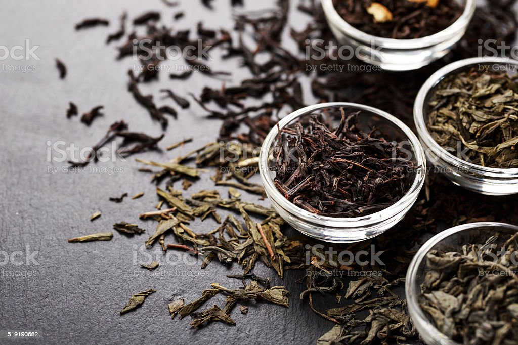 Bowls with different types of tea stock photo