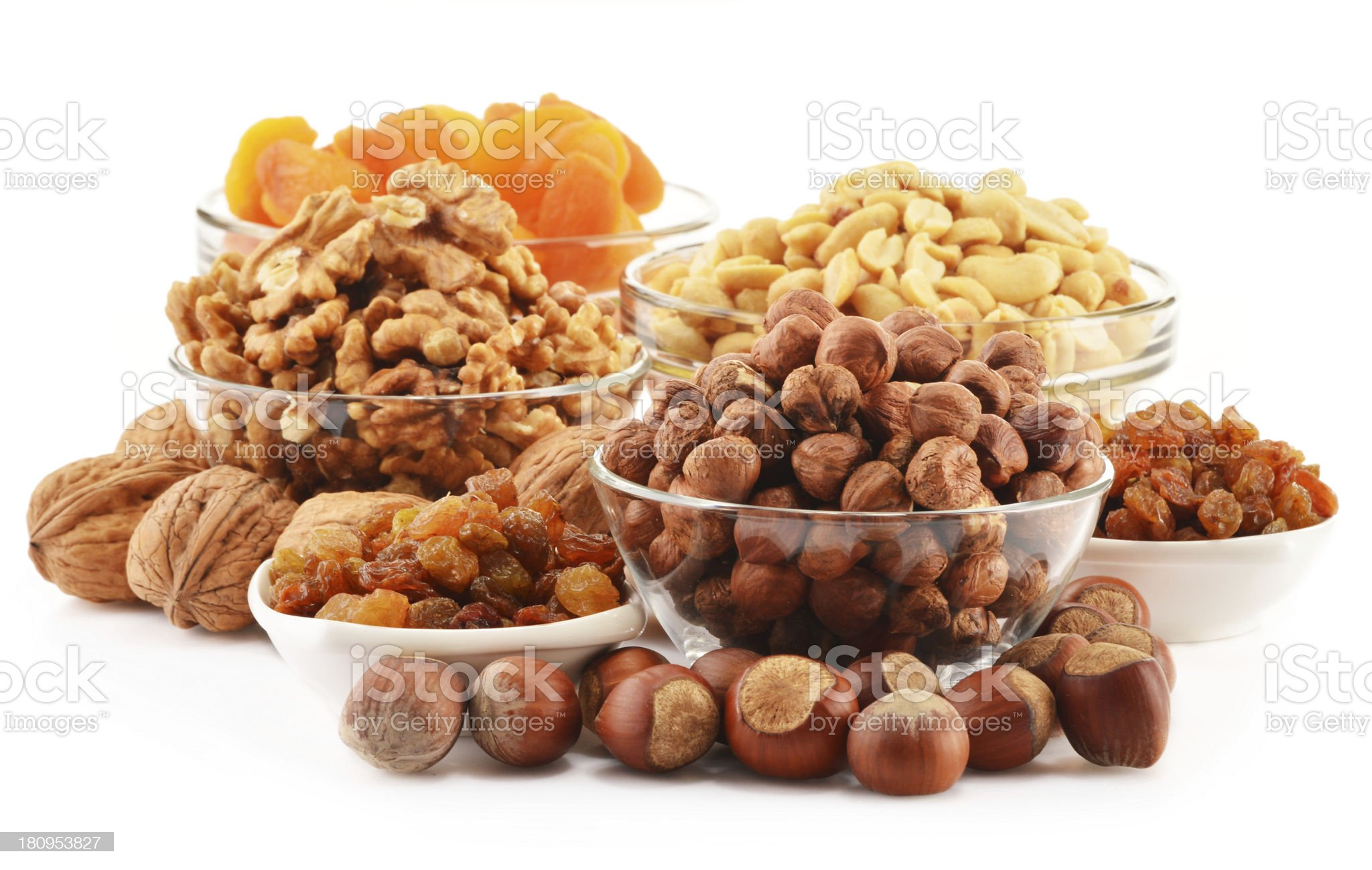 Bowls with nuts and apricots isolated on white royalty-free stock photo