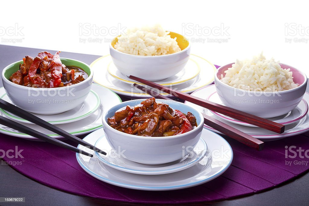 Bowls with rice and sweet sour chicken royalty-free stock photo
