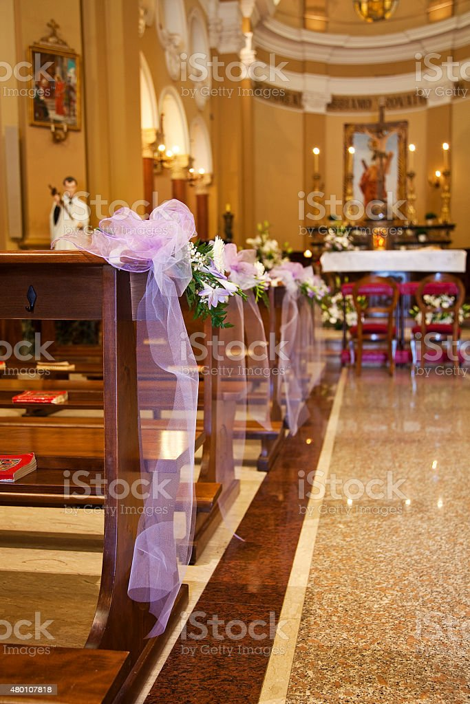 Bows in Catholic Church before a wedding stock photo